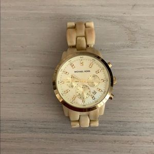 Women's gold Michael kors watch